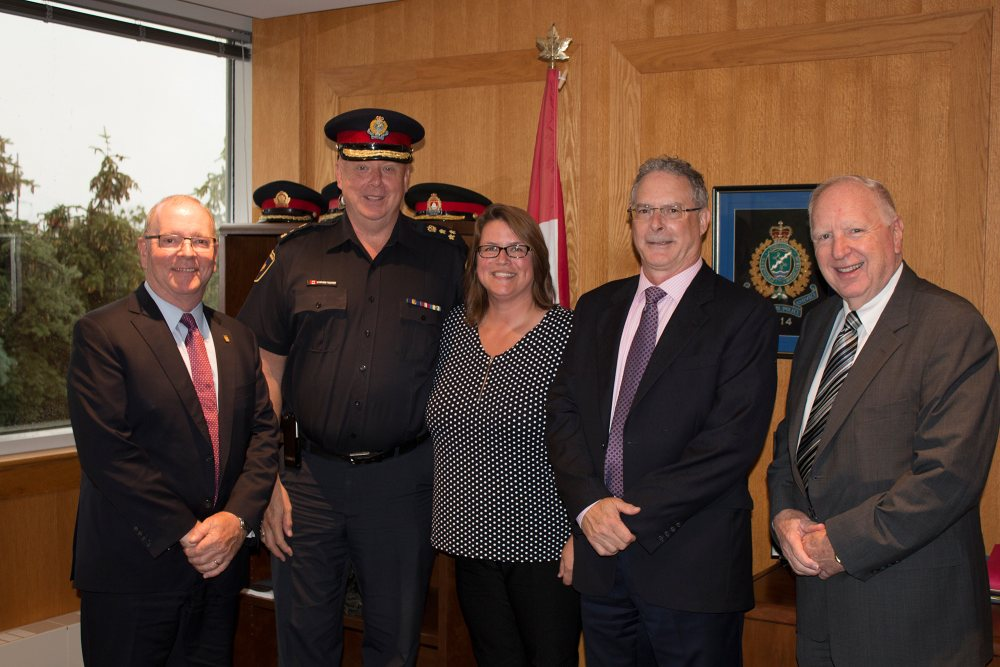 (From left) John Lever of Royal Bank, Halton Chief of Police Steven Tanner, Crime Stoppers of Halton Police Coordinator Jodi Richmond, Clive Swann of Scotiabank and Crime Stoppers of Halton Board Chair Cal Millar