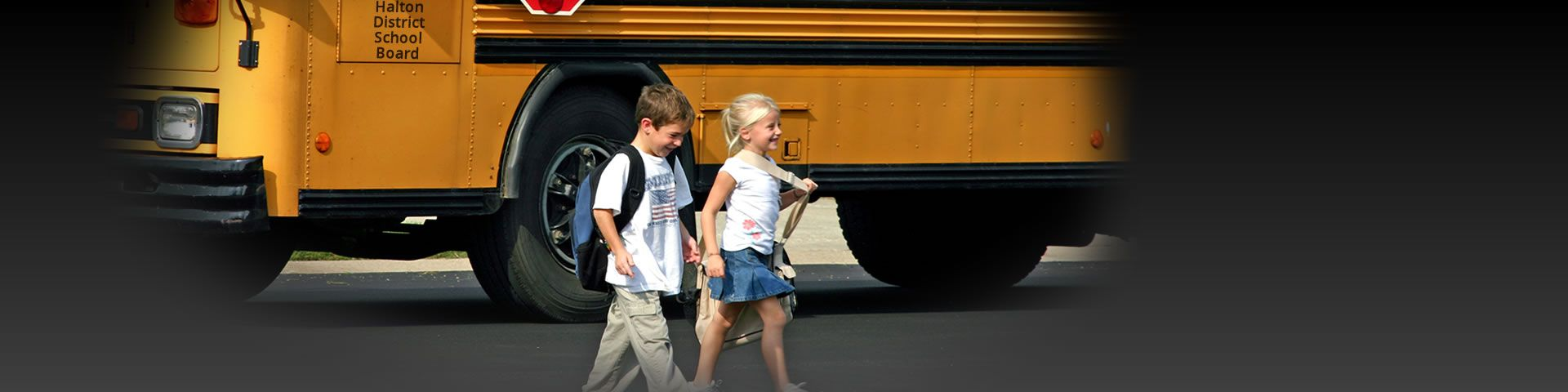 Kids getting off school bus